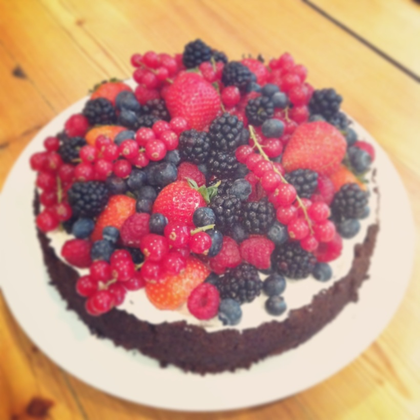 Flourless chocolate cake with creme fraiche and fresh berries